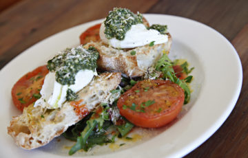 Served on ciabatta with two poached eggs, roast tomatoes, mushrooms, salad and pesto. Superb!